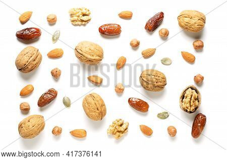 Nuts And Dried Fruits On A White Background. Sources Of Antioxidants And Vitamins. Healthy Eating. F