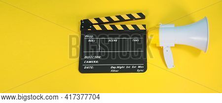 Clapperboard Or Movie Clapper Board In Yellow And Black Color And Megaphone Isolated On Yellow Backg