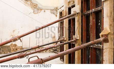 Wall Of A Construction Site With Iron Props And Reinforced Concrete