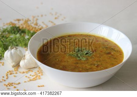 Boiled Lentils Tempered With Garlic And Spices. A Favourite Side Dish From India Popularly Known As