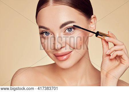 Beauty Woman Applying Black Mascara On Eyelashes With Makeup Brush. Eyelash Extensions. Makeup, Cosm