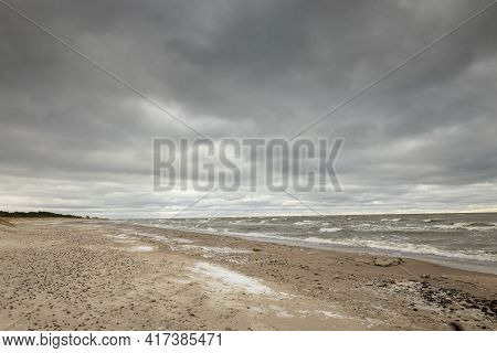 Winter Coastal Seascape With Floating Ice Fragments On Still Cold Water. Baltic Sea, Gulf Of Riga, L