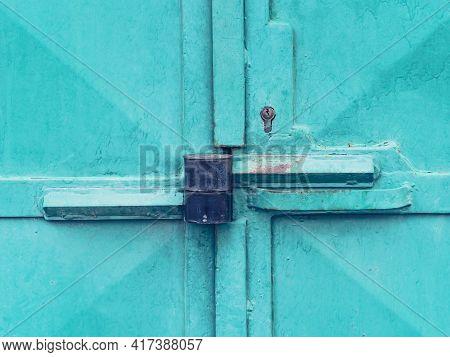 Massive Steel Door Latch With Armored Padlock. Metal Obsolet Door  In Light Green Pain