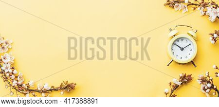 Summer Time. Spring Blossom And April Floral Nature With Alarm Clock On Yellow Background. Beautiful