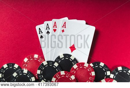 A Poker Game With A Four Of A Kind Or Quads Hand. Chips And Cards On The Red Table. Successful Win