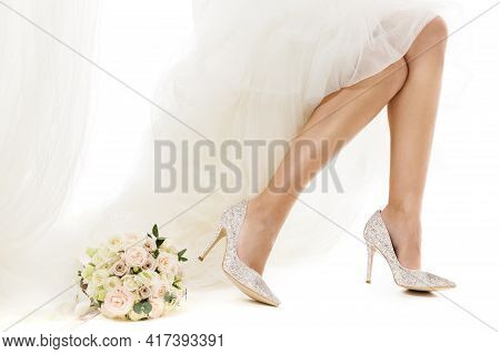 Wedding Shoes Fashion. Cinderella Bride Legs High Heels Beauty. Bridal Footwear And Rose Flowers Bou