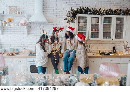 Girls Chatting, Gossiping In The Kitchen On New Years Eve