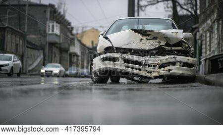 Auto Accident On The Street. A Car Damaged After A Severe Accident Stands On A City Street. Accident