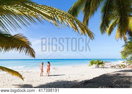 Mother And Daughter Walk On The Saona Beach In Dominican Republic