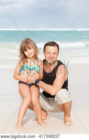 Real Family Outdoor Portrait On A Beach In Dominican Republic, Young Father With Cute Little Daughte