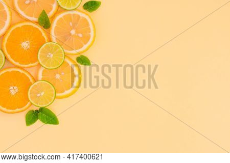 Summer, Juicy Slices Of Lemon And Orange On A Yellow Background With Copy Space. Food Concept, Top V
