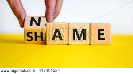 Name Or Shame Symbol. Businessman Turns The Wooden Cube And Changes The Word 'shame' To 'name' Or Vi