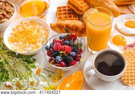 Healthy Breakfast Set With Muesli, Fruits, Berries, Nuts, Coffee, Eggs, Honey, Oat Grains And Other