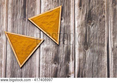 Turmeric Powder In The Triangular Bowl - Curcuma Longa