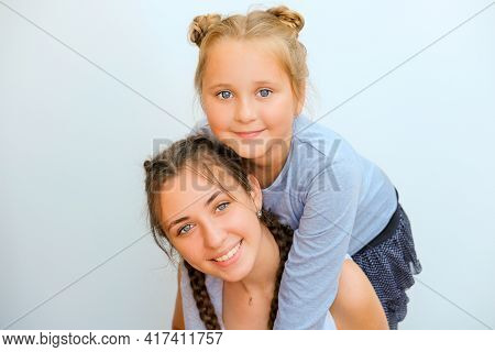 Portrait Of Two Nice Adorable Winsome Pretty Cheerful Cheery Sisters On White Isolated Background
