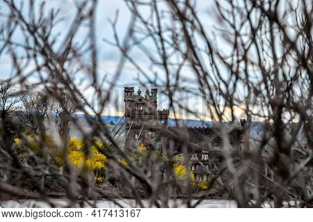 Bannerman Castle Tower Ruin, Seen Through Tree Branches During The Sunset Hours. The Focus Is On The