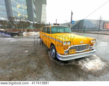 Moscow, Russia - February 27 2021: A Yellow Retro Taxi From America Of The Sixties Of Release Stands