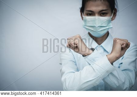 Girl Wearing Mask For Protection From Disease And Show Stop Hands Gesture For Stop Corona Virus Outb