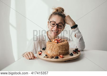 The Pastry Chef Holds A Mixer In His Hands. A Housewife Prepares A Cake. Portrait Of A Pastry Chef A