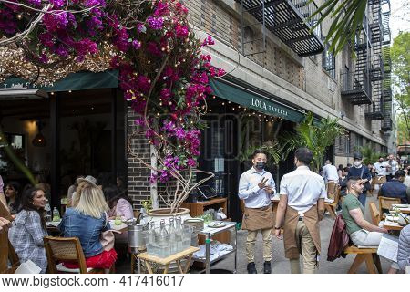 New York City - April 18 2021: Busy Outdoor Restaurant During Covid Outbreak. Restaurants Started Se