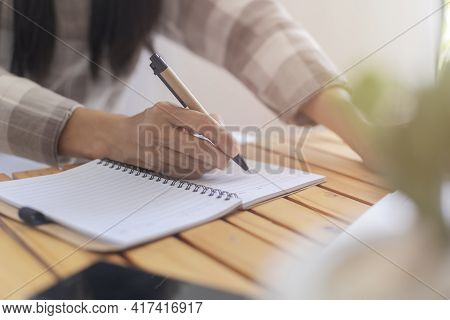 Close Up Hand Of Business Women Use Pen Writing Document Paper. Female Hand Close Up Writing With A