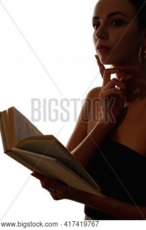 Female Silhouette. Reading Philosophy. Mindfulness Contemplation. Dark Contrast Outline Portrait Of