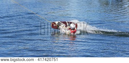 Mackay, Queensland, Australia - April 2021: Man Learning To Wakeboard At A Cable Ski Park And Fallin