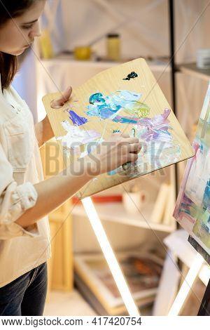 Female Painter. Art Process. Professional Artist. Artistic Equipment. Enjoying Painting. Profile Wom