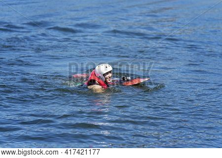 Mackay, Queensland, Australia - April 2021: Male Learning To Wakeboard At A Cable Ski Park Has Falle