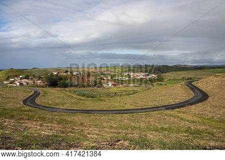 Horseshoe Shaped Road On Edge Of Small Village