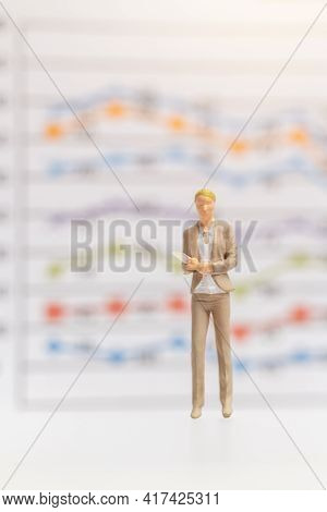 Miniature Business Woman Standing On Business Graph Background