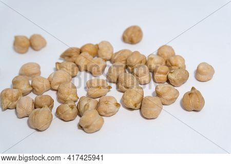 A Close Up Shot Of Chickpeas In Studio Settings.chickpeas, Also Known As Garbanzo Beans, Are Part Of