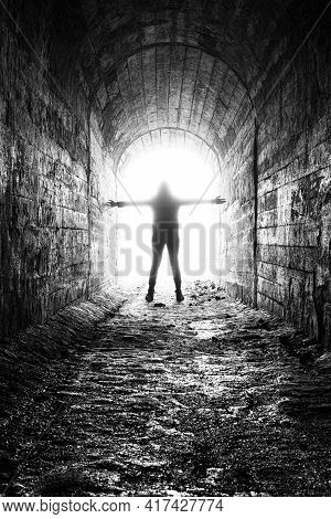 The Woman Plunges Into The Milky Light At The End Of The Tunnel. The Dying Man Comes Out Into The Li