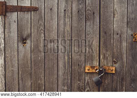 Background Texture. Aged Wood Doors With Rusty Metal Rivets And Barn Lock, Copy Space