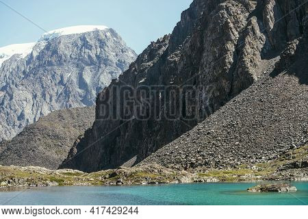 Scenic Landscape With Azure Mountain Lake And Snowy Mountain Top In Sunlight. Turquoise Clear Water