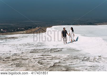 Couple In Pamukkale. A Man And A Woman Are Traveling. Couple In Love Walking. Travelling To Turkey.