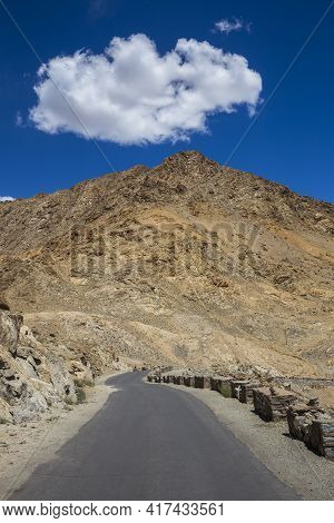 Asphalt Road In The Himalayas Mountains And White Cloud On The Blue Sky In Ladakh Region, Jammu And