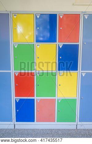 Empty Clean Hallway Corridor Classroom With Colored Furniture Lockers And Door Room At School Or Uni