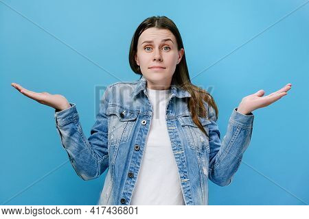 Disgruntled Confused Annoyed Young Millennial Woman Raising Hands, Indignantly Asking Reason Of Fail