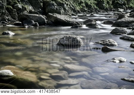 Clear Calm Water At The Bank Of A Rushing River
