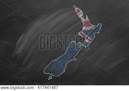 Country Map And Flag Of New Zealand Drawing With Chalk On A Blackboard. One Of A Large Series Of Map
