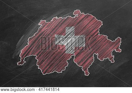 Country Map And Flag Of Switzerland Drawing With Chalk On A Blackboard. One Of A Large Series Of Map