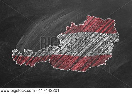 Country Map And Flag Of Austria Drawing With Chalk On A Blackboard. One Of A Large Series Of Maps An