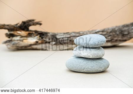 Pile Of Gray Stones On Beige Background. Simple Balancing Stones, Simplicity Of Harmony And Balance.