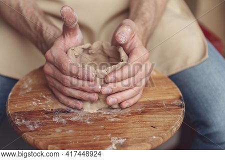 The Master Creates A White Clay Product. The Masters Hands Clos