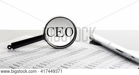 Magnifying Glass With Text Ceo On The Chart Background With Pen