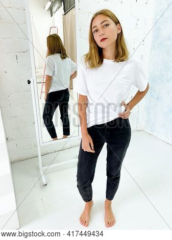 Beautiful Young Woman In Blank White T-shirt And Black Jeans