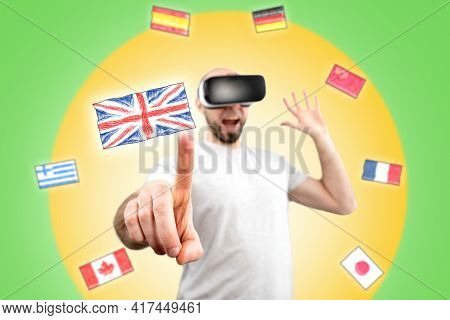 A Surprised Man In Virtual Reality Glasses Clicks On The Flag Of The United Kingdom On The Virtual I