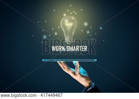 Work Smarter Concept With Digital Tablet And Light Bulb In Pcb Design. Digitization And Digitalizati