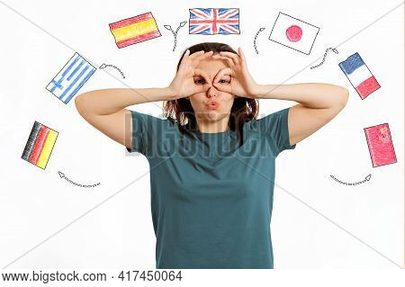 English Language Day. Portrait Of A Woman Making A Funny Grimace On Her Face. White Background With